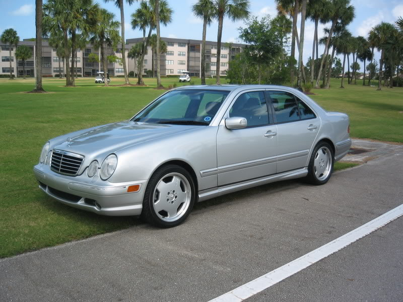 Used, silver Mercedes-Benz E-Class car, E 55 AMG, W210 model, 4-door saloon