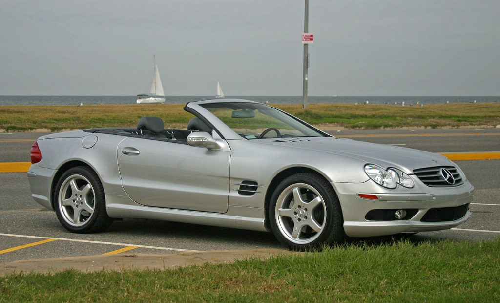 Used, silver Mercedes-Benz SL-Class car, R230 model on AMG wheels, hardtop convertible with the roof down