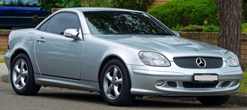 Used, silver Mercedes-Benz SLK-Class car, R170 model, hardtop convertible with the roof closed