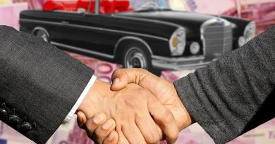 Purchase of a second-hand car, buyer and seller shaking hands, used Mercedes-Benz car in the back