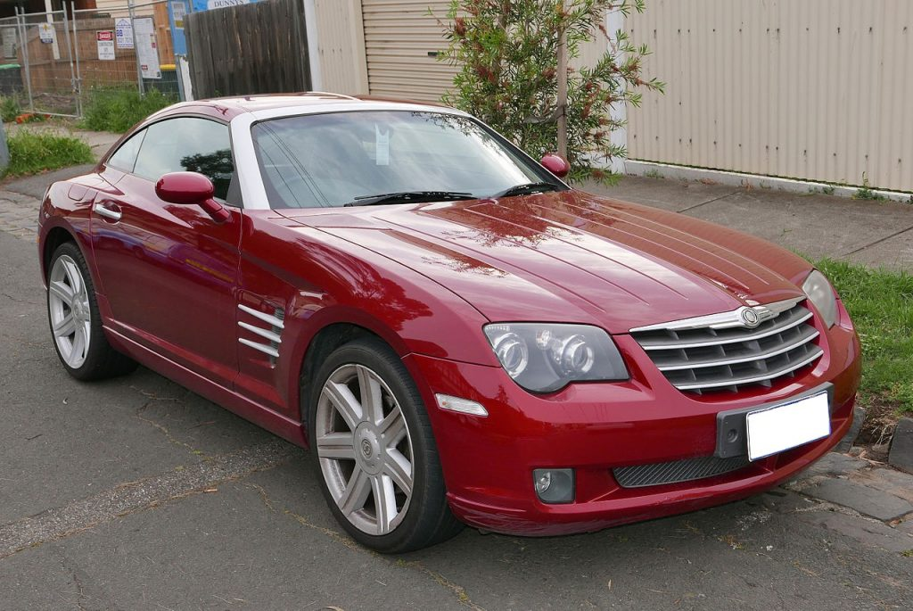 Used, red Chrysler Crossfire coupe on OEM staggered wheels