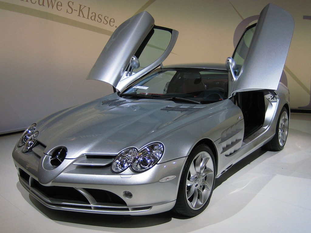 Silver Mercedes-Benz SLR McLaren with its gullwing doors up