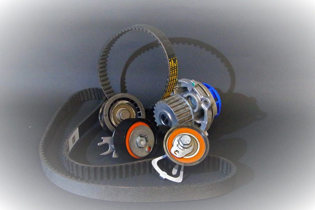 Timing belt kit consisting of two cambelts, two tensioners, a water pump and an idler pulley