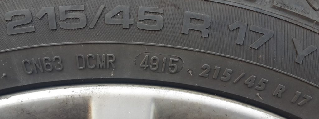 Tyre markings showing date of production and tyre size, four digit code
