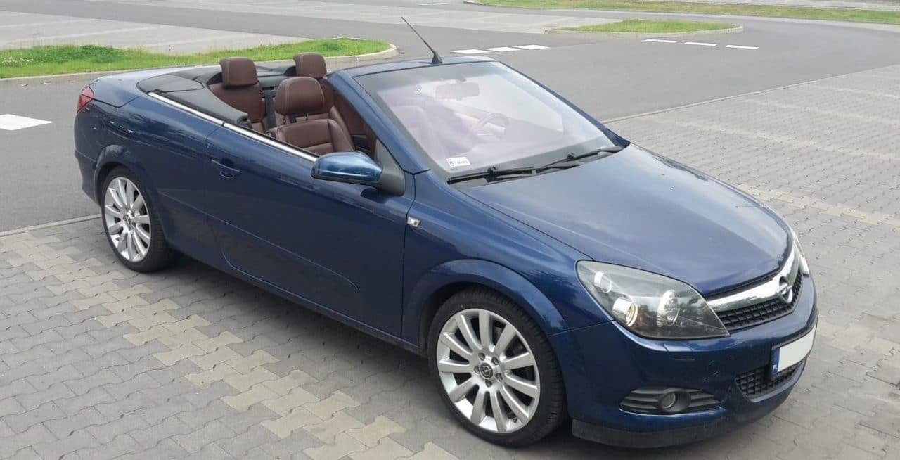 Used, blue Vauxhall Astra Twintop on 18 inch OEM wheels, hardtop convertible with the roof open
