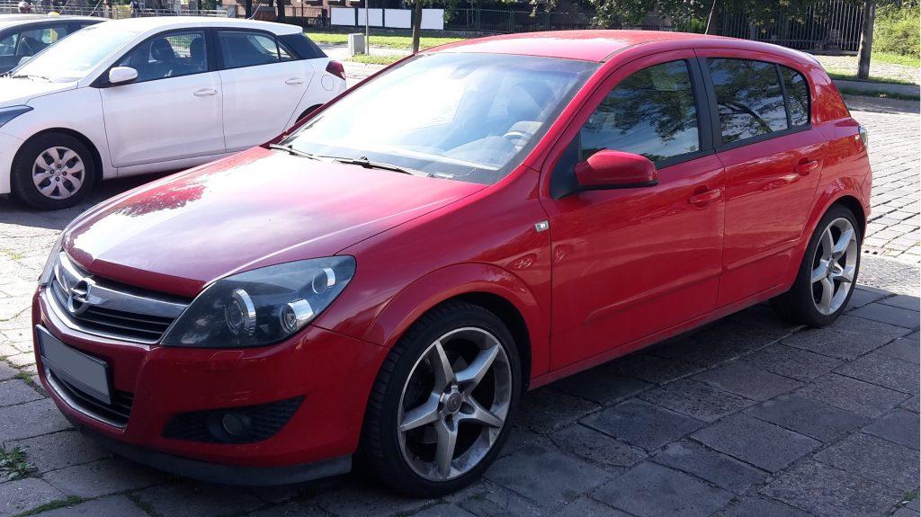 Used, red Vauxhall Astra H on 18 inch OEM wheels, 5-door hatchback