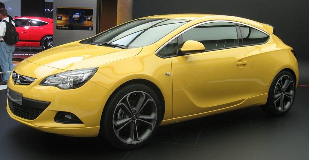 "Used, yellow Opel Astra J GTC on 20"" OEM wheels"