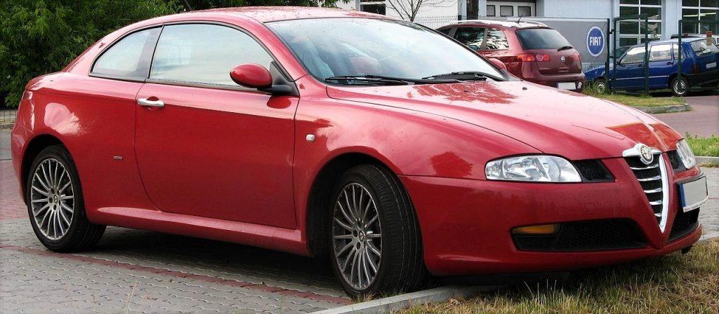 Used, red Alfa Romeo GT on OEM alloy wheels.