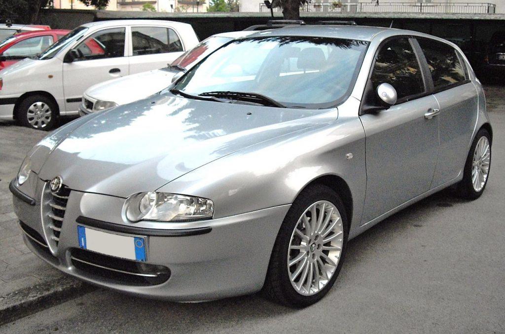 Used, grey Alfa Romeo 147 on OEM alloy wheels. A pre-facelift model.