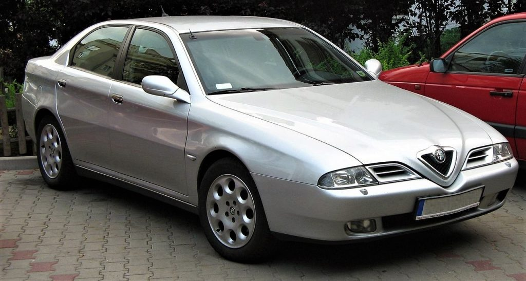 Used, grey Alfa Romeo 166 on OEM alloy wheels. Pre-facelift model